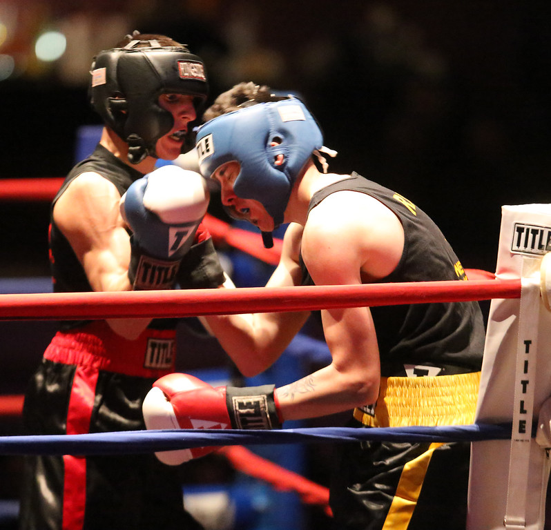 . Greater Lowell Golden Gloves boxing, week 2. Robert Tomczyk of Palladin Martial Arts (Blue corner), left, won by unanimous decision vs Scott Nardella of Lowell West End Gym (Red corner) in 141 lb Novice bout. (SUN/Julia Malakie)