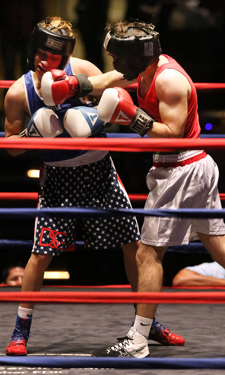 . Greater Lowell Golden Gloves boxing, week 2. Kevin Rodriguez of Intenze 978 (Blue corner), left, won by unanimous decision vs Giovanni Picariello of Nonantum Boxing (Red corner), right, in 132 lb Novice bout. (SUN/Julia Malakie)
