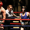 Central/ Lowell Golden Gloves boxing. Preliminary bouts, Novice. Anthony Cefalo of South Boston & Peter Welch's Gym (Red corner), left, won in unanimous decision over Duncan McNeil of Groveland & Haverhill Downtown, seen here after getting up from the mat, in 141 lb Novice bout. Referee is Melissa Kelly. (SUN/Julia Malakie)