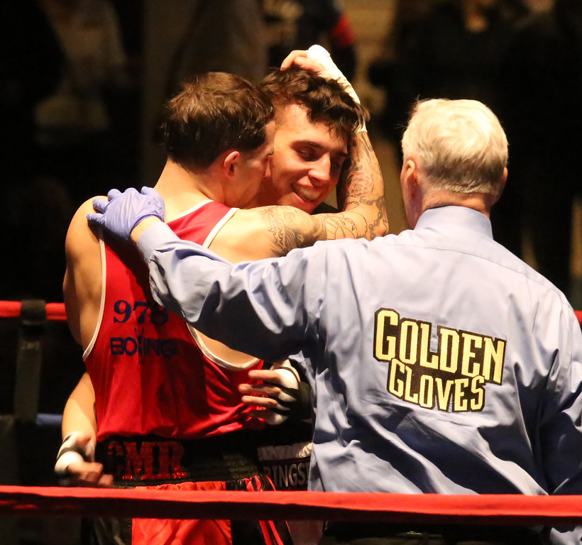 . Central/ Lowell Golden Gloves boxing. Preliminary bouts, Novice. Gabriel Morales of Dracut & Intenze 978 (Red corner), left, won by unanimous decision over Gabriel Gerolomo of Lowell & Canal Street, in 141 lb Novice bout. Referee is Mike Ryan. (SUN/Julia Malakie)