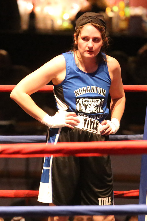 . Central/Lowell Golden Gloves boxing. Preliminary bouts, Novice. Jessica Jones of West Roxbury & Nonantum Boxing Club, after final bell in 132 lb Novice Female. Paige Eggerbrecht of Waltham & Nolan Bros. won in 3-2 decision. (SUN/Julia Malakie)