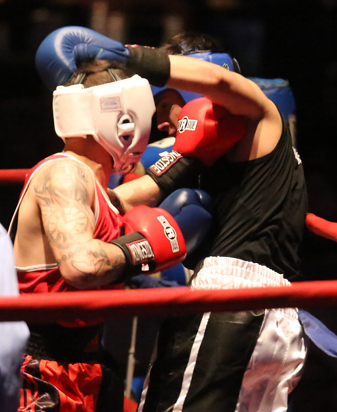 Central/ Lowell Golden Gloves boxing. Preliminary bouts, Novice. Gabriel Morales of Dracut & Intenze 978 (Red corner), left, won by unanimous decision over Gabriel Gerolomo of Lowell & Canal Street, in 141 lb Novice bout. (SUN/Julia Malakie)