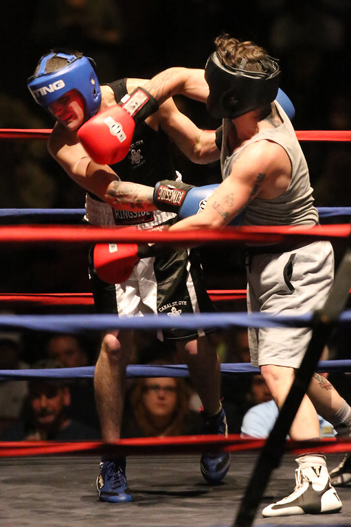 . Central/ Lowell Golden Gloves boxing. Preliminary bouts, Novice. Patrick Murphy of Lowell & Canal Street (Blue corner), left, won by unanimous decision over Gregory Bono of Watertown & Nolan Bros. Boxing, in 152 lb Novice bout. (SUN/Julia Malakie)