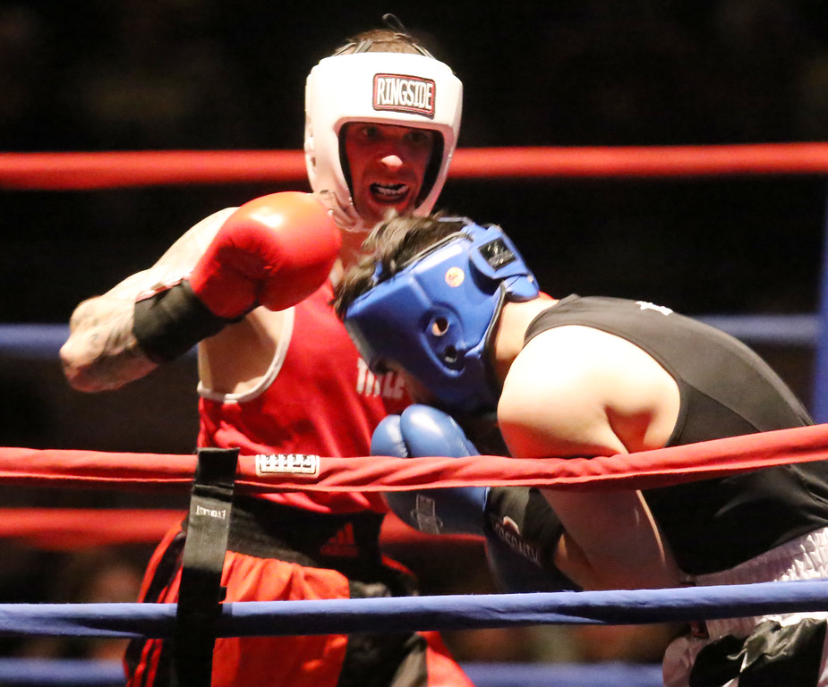 . Central/ Lowell Golden Gloves boxing. Preliminary bouts, Novice. Gabriel Morales of Dracut & Intenze 978 (Red corner), left, won by unanimous decision over Gabriel Gerolomo of Lowell & Canal Street, in 141 lb Novice bout. (SUN/Julia Malakie)