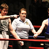 Central/ Lowell Golden Gloves boxing. Preliminary bouts, Novice. Anthony Cefalo of South Boston & Peter Welch's Gym (Red corner), left, won in unanimous decision over Duncan McNeil of Groveland & Haverhill Downtown, in 141 lb Novice bout. Referee is Melissa Kelly. (SUN/Julia Malakie)