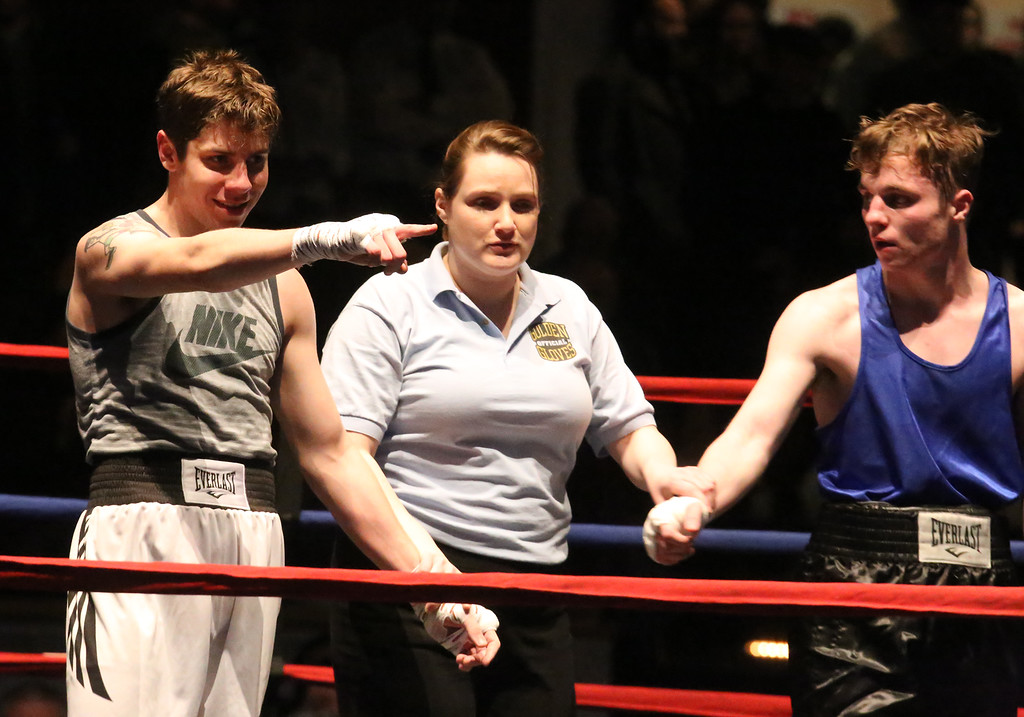 . Central/ Lowell Golden Gloves boxing. Preliminary bouts, Novice. Anthony Cefalo of South Boston & Peter Welch\'s Gym (Red corner), left, won in unanimous decision over Duncan McNeil of Groveland & Haverhill Downtown, in 141 lb Novice bout. Referee is Melissa Kelly. (SUN/Julia Malakie)