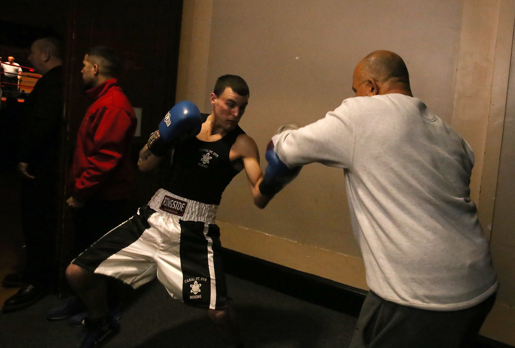 . Central/ Lowell Golden Gloves boxing. Preliminary bouts, Novice. Patrick Murphy of Lowell & Canal Street getting ready before his bout, with trainer David Ortiz. He won by unanimous decision over Gregory Bono of Watertown & Nolan Bros. Boxing, in 152 lb Novice bout. (SUN/Julia Malakie)