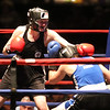 Central/ Lowell Golden Gloves boxing. Preliminary bouts, Novice. Paige Eggerbrecht of Waltham & Nolan Bros. (Red corner), left, won in 3-2 decision ovr Jessica Jones of West Roxbury & Nonantum Boxing Club in 132 lb Novice Female. (SUN/Julia Malakie)