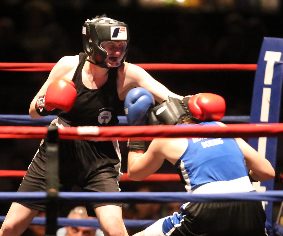 . Central/ Lowell Golden Gloves boxing. Preliminary bouts, Novice. Paige Eggerbrecht of Waltham & Nolan Bros. (Red corner), left, won in 3-2 decision ovr Jessica Jones of West Roxbury & Nonantum Boxing Club in 132 lb Novice Female. (SUN/Julia Malakie)
