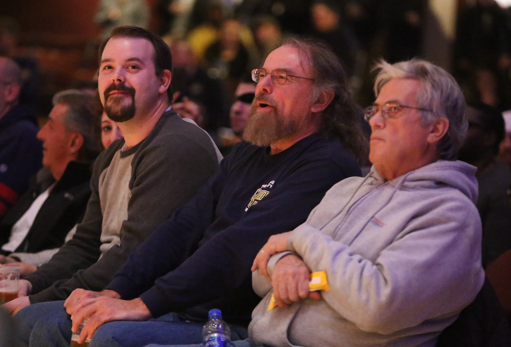 . Central/ Lowell Golden Gloves boxing. Preliminary bouts, Novice. Spectators, from left, Nathan Landry of Burlington, Max Logan of Nashua, and Joe Germann of Chelmsford. (SUN/Julia Malakie)