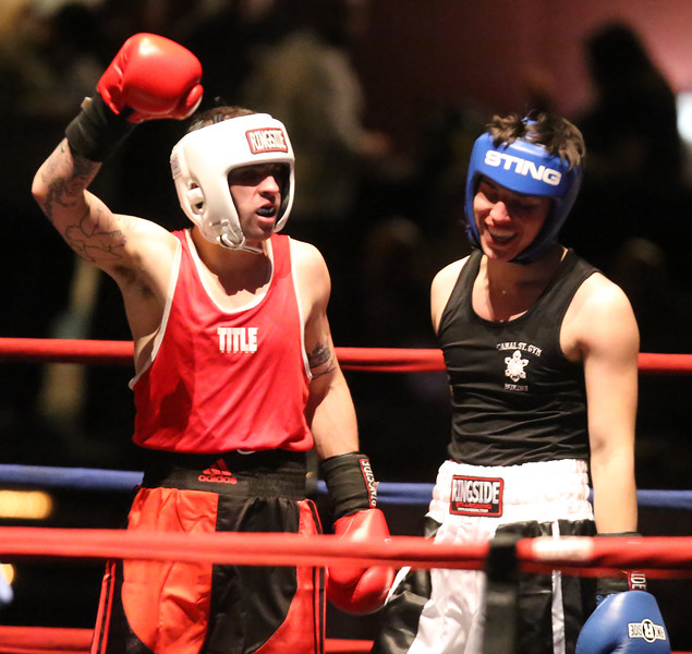 Central/ Lowell Golden Gloves boxing. Preliminary bouts, Novice. Both boxers seem satisfied after final bell. Gabriel Morales of Dracut & Intenze 978, left, won by unanimous decision over Gabriel Gerolomo of Lowell & Canal Street, in 141 lb Novice bout. (SUN/Julia Malakie)