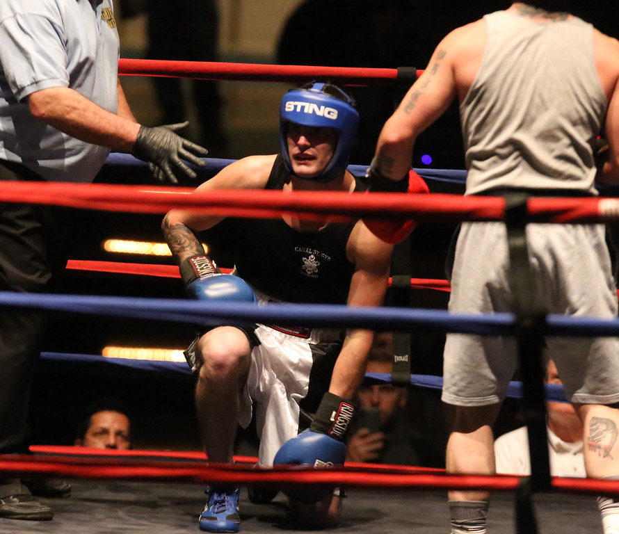 . Central/ Lowell Golden Gloves boxing. Preliminary bouts, Novice. Patrick Murphy of Lowell & Canal Street (Blue corner)gets up after being partially knocked down. Despite looking much on defensive he won by unanimous decision over Gregory Bono of Watertown & Nolan Bros. Boxing, in 152 lb Novice bout. (SUN/Julia Malakie)