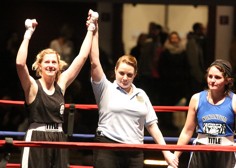 Central/ Lowell Golden Gloves boxing. Preliminary bouts, Novice. Paige Eggerbrecht of Waltham & Nolan Bros. (Red corner) won in 3-2 decision ovr Jessica Jones of West Roxbury & Nonantum Boxing Club in 132 lb Novice Female. Referee is Melissa Kelly. (SUN/Julia Malakie)