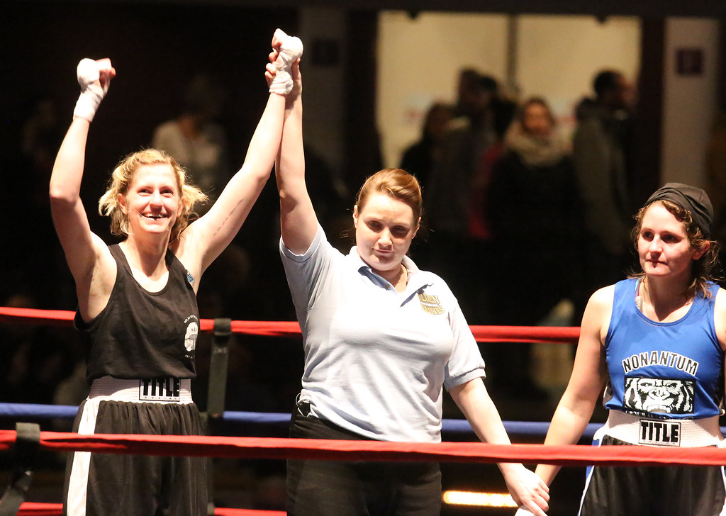 . Central/ Lowell Golden Gloves boxing. Preliminary bouts, Novice. Paige Eggerbrecht of Waltham & Nolan Bros. (Red corner) won in 3-2 decision ovr Jessica Jones of West Roxbury & Nonantum Boxing Club in 132 lb Novice Female. Referee is Melissa Kelly. (SUN/Julia Malakie)