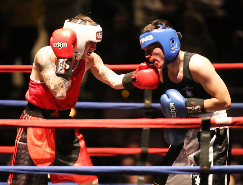Central/ Lowell Golden Gloves boxing. Preliminary bouts, Novice. Gabriel Morales of Dracut & Intenze 978 (Red corner) won by unanimous decision over Gabriel Gerolomo of Lowell & Canal Street, in 141 lb Novice bout. (SUN/Julia Malakie)