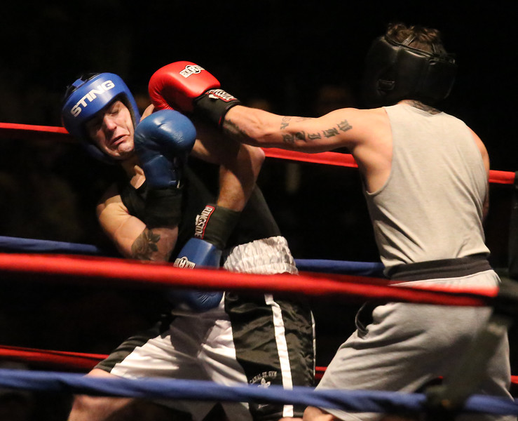 Central/ Lowell Golden Gloves boxing. Preliminary bouts, Novice. Patrick Murphy of Lowell & Canal Street (Blue corner), left, won by unanimous decision over Gregory Bono of Watertown & Nolan Bros. Boxing, in 152 lb Novice bout. (SUN/Julia Malakie)