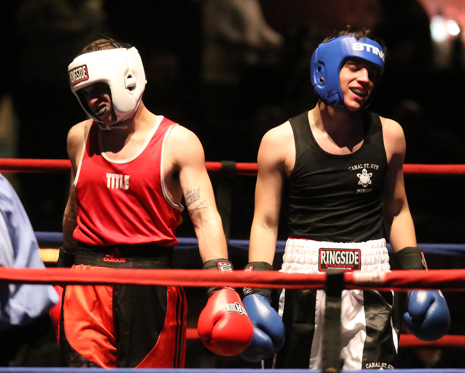 . Central/ Lowell Golden Gloves boxing. Preliminary bouts, Novice. Both boxers seem satisfied after final bell. Gabriel Morales of Dracut & Intenze 978, left, won by unanimous decision over Gabriel Gerolomo of Lowell & Canal Street, in 141 lb Novice bout. (SUN/Julia Malakie)
