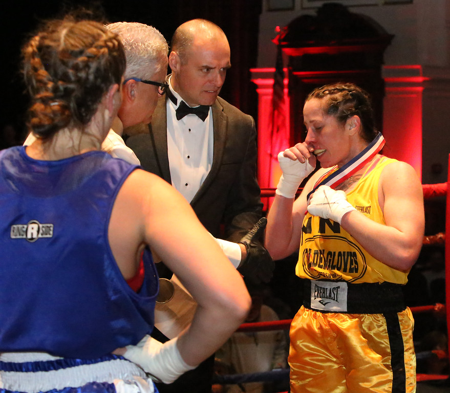 . New England Golden Gloves Open Championships. Liz Leddy of Portland, right, won by decision over Jacki Boyle of Stamford, CT , left, in Women\'s 132 lb Open. Referee is Kevin Smith.  (SUN Julia Malakie)
