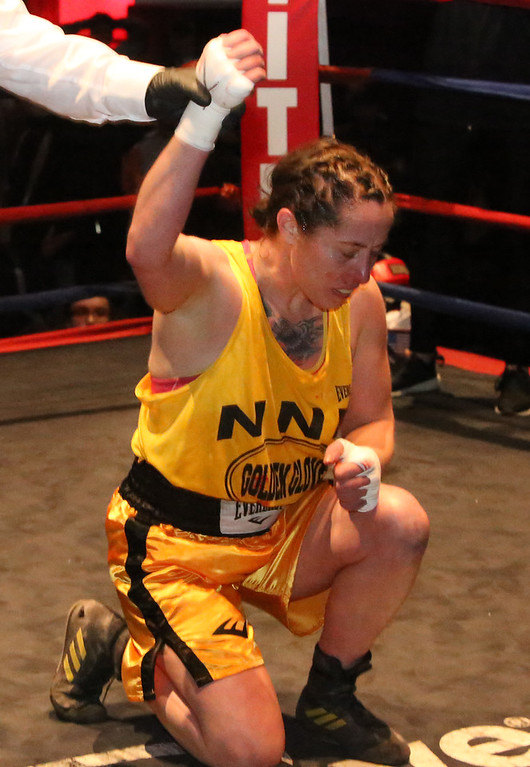 . New England Golden Gloves Open Championships. Liz Leddy of Portland is declared winner by decision over Jacki Boyle of Stamford, CT in Women\'s 132 lb Open. Referee is Kevin Smith.  (SUN Julia Malakie)
