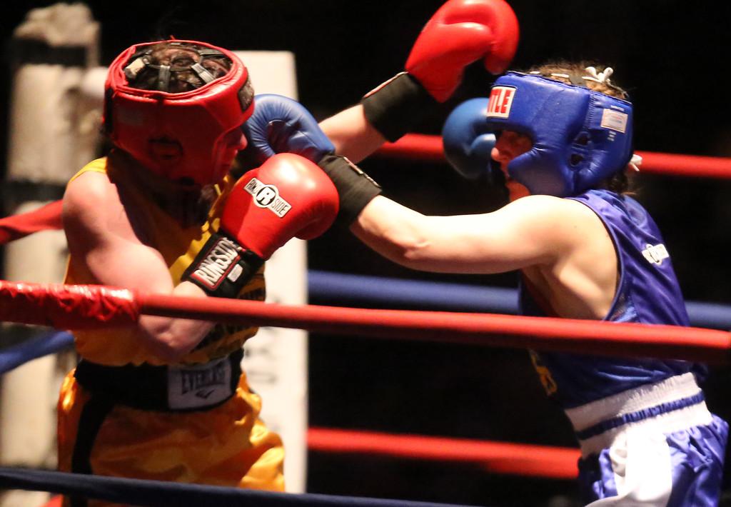 . New England Golden Gloves Open Championships. Liz Leddy of Portland (Red corner), left, won by decision over Jacki Boyle of Stamford, CT (Blue) in Women\'s 132 lb Open. (SUN Julia Malakie)