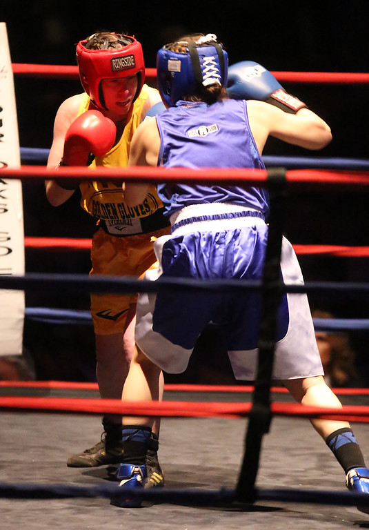 . New England Golden Gloves Open Championships. Liz Leddy of Portland (Red corner), left, won by decision over Jacki Boyle of Stamford, CT (Blue) in Women\'s 132 lb Open. Referee is Kevin Smith.  (SUN Julia Malakie)