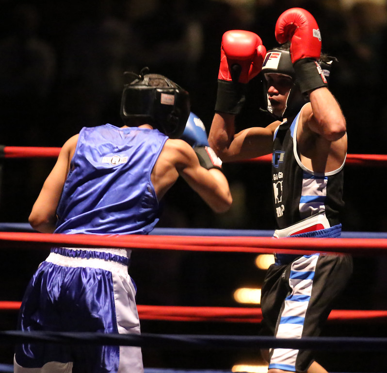 . New England Golden Gloves Open Championships. Joshua Foster of New Haven (Blue corner), left, won by 3-2 decision over Elijah Peixoto of East Providence in 132 lb Open.  (SUN Julia Malakie)
