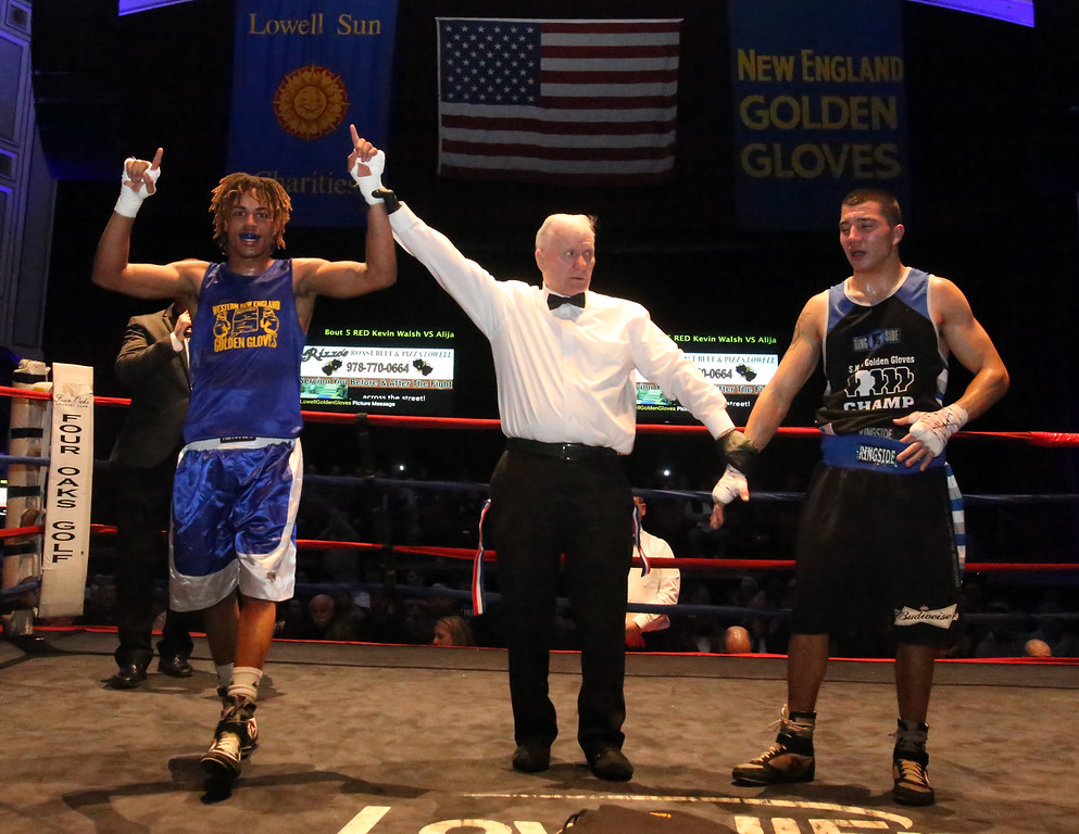 . New England Golden Gloves Open Championships. Alejandro Paulino of New London, CT (Blue corner) won by decision over Kevin Walsh of Brockton (Red) in 141 lb Open. Referee is Mike Ryan.  (SUN Julia Malakie)