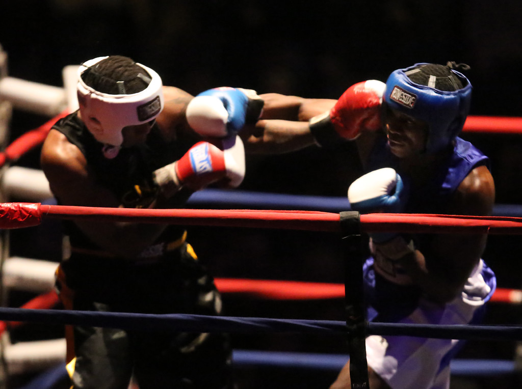 . New England Golden Gloves Open Championships. Demek Edmonds of Worcester (Blue corner), right, won by unanimous decision over Edmond Worley of Lowell (Red) in 201 lb Open. Referee is Stephem Clark.  (SUN Julia Malakie)