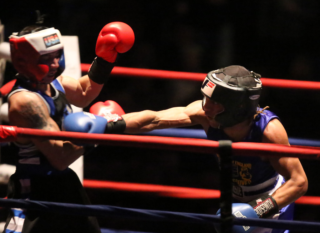 . New England Golden Gloves Open Championships. Alejandro Paulino of New London, CT (Blue corner), right, won by decision over Kevin Walsh of Brockton (Red) in 141 lb Open. Referee is Mike Ryan.  (SUN Julia Malakie)