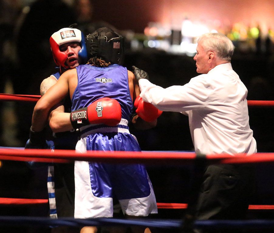 . New England Golden Gloves Open Championships. Alejandro Paulino of New London, CT (Blue corner), center, won by decision over Kevin Walsh of Brockton (Red), left, in 141 lb Open. Referee is Mike Ryan.  (SUN Julia Malakie)