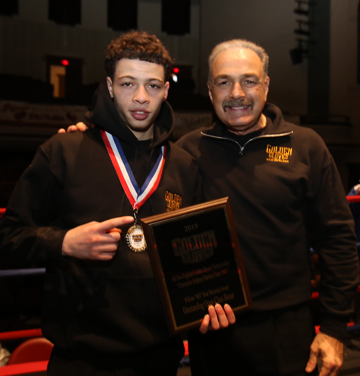 . New England Golden Gloves Open Championships. Trophy presentation & New England team.  Felix Parrilla of New Haven and Southern New England, and 123 lb Open champion, with his Outstanding Open Class Boxer award, presented by tournament director Bobby Russo. (SUN Julia Malakie)