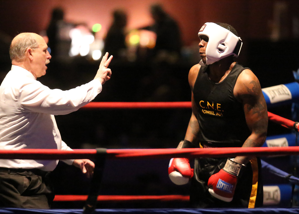 . New England Golden Gloves Open Championships. Demek Edmonds of Worcester (Blue corner) won by unanimous decision over Edmond Worley of Lowell (Red) in 201 lb Open. Referee Stephem Clark does count on Worley after he was knocked down in first round.  (SUN Julia Malakie)