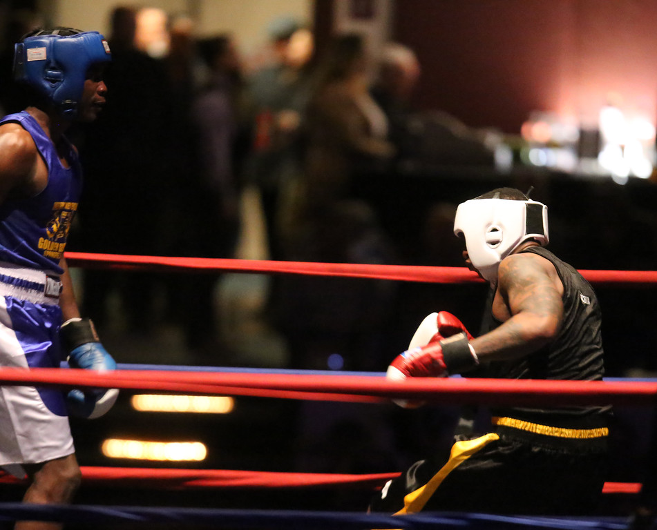 . New England Golden Gloves Open Championships. Demek Edmonds of Worcester (Blue corner) won by unanimous decision over Edmond Worley of Lowell (Red) in 201 lb Open. Worley is knocked down in the first round. (SUN Julia Malakie)