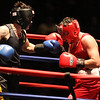 Golden Gloves boxing - week 3. Alexander Lynch of Grealish Boxing (Blue corner), left, won by majority decision over Konstantinos Papatsas of Nonantum Boxing in 152 lb Novice bout. Referee is Jackie Morrill. (SUN/Julia Malakie)