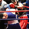 Golden Gloves boxing - week 3. Shane Jordon of Everybody Fights (Red corner), right, won by unanimous decision over Michael Correa of Manchester PAL (Blue) in 132 lb Novice semifinal. Referee is Jackie Morrill. (SUN/Julia Malakie)