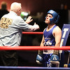 Golden Gloves boxing - week 3. Referee Jackie Morrill does count on Michael Correa of Manchester PAL (Blue). Shane Jordon of Everybody Fights (Red corner) won by unanimous decision over Correa in 132 lb Novice semifinal. (SUN/Julia Malakie)