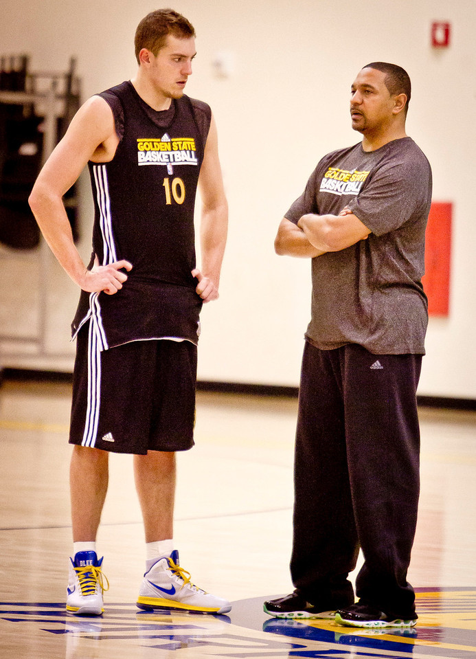 Warriors head coach Mark Jackson talks with David Lee after the Golden State Warriors practice in Oakland , Calif., on Thursday, December 22, 2011.