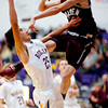 S1212BOULDER4.jpg S1212BOULDER4<br /> Boulder's #25, Alejandro Rodriguez , puts one up as Golden's #21, Austin Rickard, defends during the first quarter of their game at Boulder High School on Tuesday December 11th, 2012.<br /> <br /> Photo by: Jonathan Castner