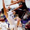 S1212BOULDER4.jpg S1212BOULDER4<br /> Boulder's #25, Alejandro Rodriguez , puts one up as Golden's #21, Austin Rickard, defends during the first quarter of their game at Boulder High School on Tuesday December 11th, 2012.<br /> <br /> Photo by: Jonathan Castner