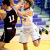 S1212BOULDER1.jpg S1212BOULDER1<br /> Boulder's #22. RJ Lampert collides with Golden's #11, Nolan Holmes during the first quarter of their game at Boulder High School on Tuesday December 11th, 2012. Lampert was given a technical foul and Holmes recieved a foul for blocking.<br /> <br /> Photo by: Jonathan Castner