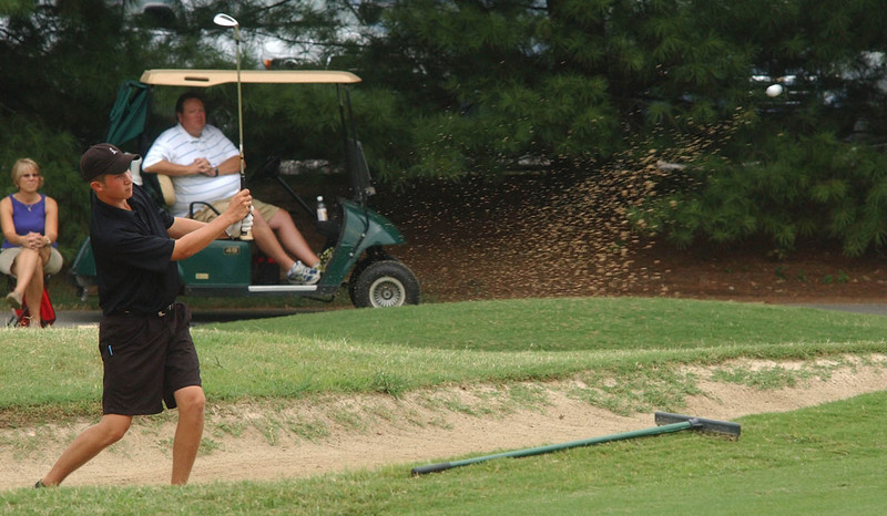 Brian Jaska hits bunker shot on 18 Monday in the McDonald's Tournament of Champions at Ridgefields. Photo by David Grace