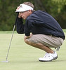 Casey Flenniken of TN Wesleyan measures the distance of his putt during the VIC Invitational. Photo by Erica Yoon