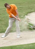 Jared Songster of Milligan tries to putt out of a bunker at Hole 13. Photo by Erica Yoon