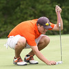 Adam Latulippe lines up his shot at Hole 9. Photo by Erica Yoon