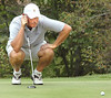 M. Freels lines up putt on the 18th green. Photo by Ned Jilton II