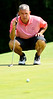 Defending champion Buck Brittain reads the green before taking his putt on the par-4 14th hole during second round action Saturday in the 60th Ridgefields Mens Invitational at Ridgefields Country Club in Kingsport. Photo by Kris Wilson - kswilson@timesnews.net