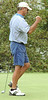 M. Runyan celebrates hitting a long putt on the 18th green. Photo by Ned Jilton II