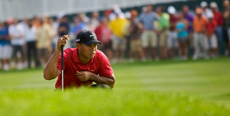 09-08-2009:  Tiger Woods reads a putt on the 15th hole at Firestone Country Club