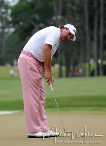 May 13, 2012; Ponte Vedra Beach, FL, USA; Phil Mickelson putts on the 1st hole during the fourth round of the PLAYERS Championship at TPC Sawgrass. Mandatory Credit: Melina Vastola-US PRESSWIRE