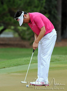 May 13, 2012; Ponte Vedra Beach, FL, USA; Charlie Wi putts on the 2nd hole during the fourth round of the PLAYERS Championship at TPC Sawgrass. Mandatory Credit: Melina Vastola-US PRESSWIRE
